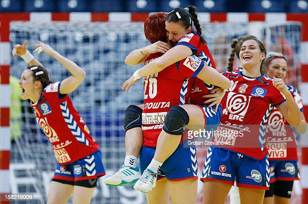 Jelena Popovic and Biljana Filipovic of Serbia celebrate victory against Denmark after the Women's European Handball Championship 2012 Group I main...