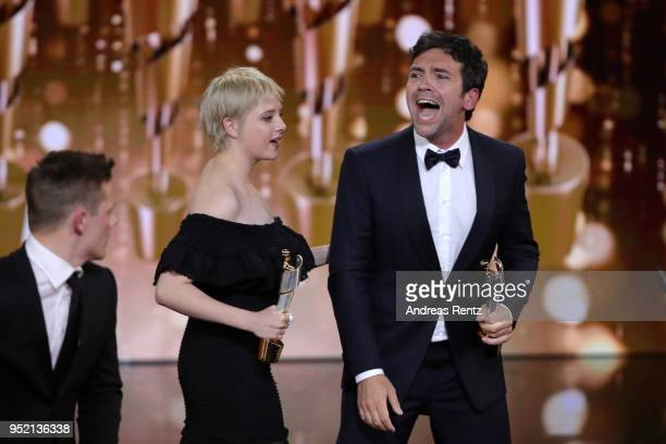 Jella Haase and Bora Dagtekin accept the award 'Biggest Movie Audience' for the film 'Fack ju Goehte' on stage during the Lola German Film Award show...