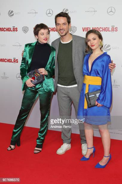 Jella Haase, Marc Benjamin and Emma Drogunova attend the premiere of 'Vielmachglas' at Cinedom on March 5, 2018 in Cologne, Germany.
