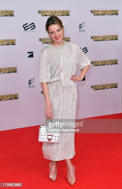 "Jella Haase, wearing an outfit by COS and a handbag by Coccinelle, attends the premiere of the movie ""Goldfische"" at Mathaeser Filmpalast on March..."