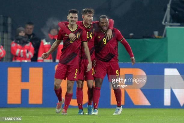 Jelle Bataille of Belgium, Maxime Busi of Belgium and Lois Openda of Belgium celebrates after scoring his team's second goal with team mates during...