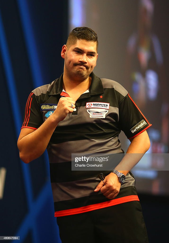 Jelle Klaasen of Holland celebrates winning his first round match against Christian Kist of Holland during the William Hill PDC World Darts Championships on Day One at Alexandra Palace on December 18, 2014 in London, England.