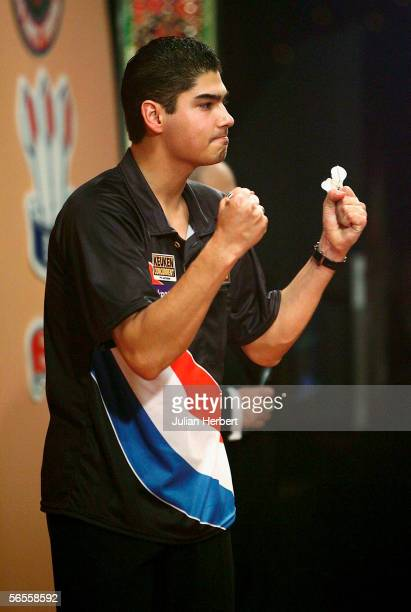 Jelle Klaasen of Holland shows his delight in beating Mervyn King of England during the second round of the BDO World Darts Championships at the...