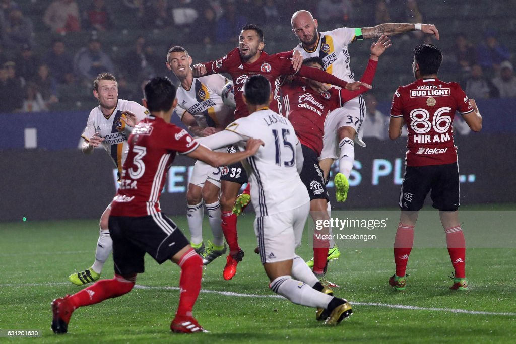 Jelle van Damme #37 and Daniel Steres #44 of the Los Angeles Galaxy vie for the corner kick with Jorge Alberto Ortiz #32 of Club Tijuana during the first half of their friendly match at StubHub Center on February 7, 2017 in Carson, California.