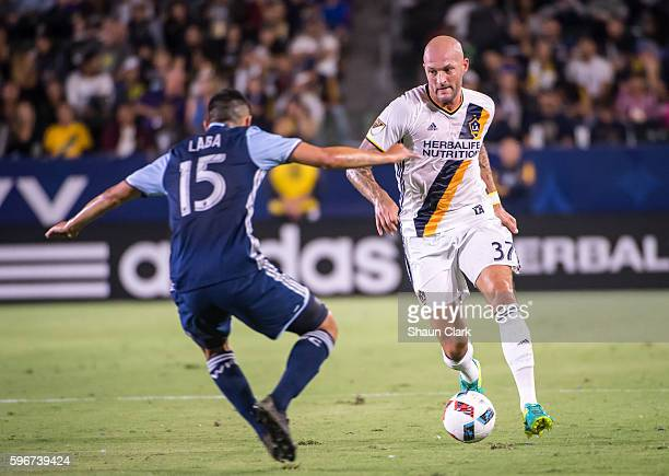Jelle Van Damme of Los Angeles Galaxy and Matias Laba of Vancouver Whitecaps during Los Angeles Galaxy's MLS match against Vancouver Whitecaps at the...