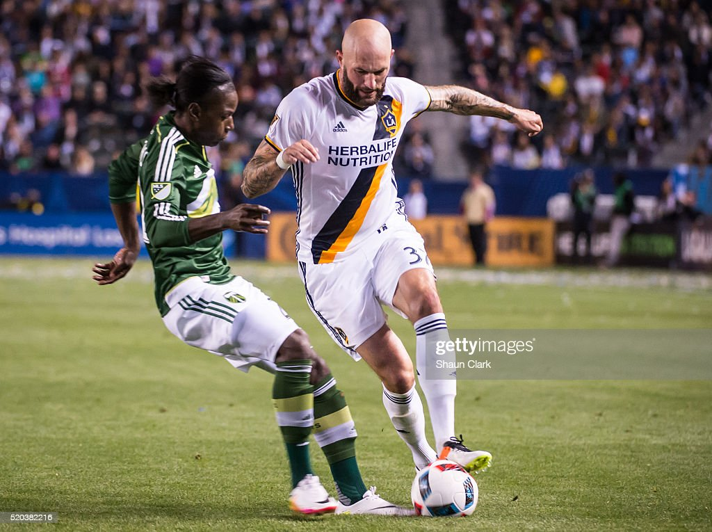 Jelle Van Damme #37 of Los Angeles Galaxy dribbles around Diego Chara #21 of Portland Timbers during Los Angeles Galaxy's MLS match against Portland Timbers at the StubHub Center on April 10, 2016 in Carson, California. The match ended in a 1-1 tie