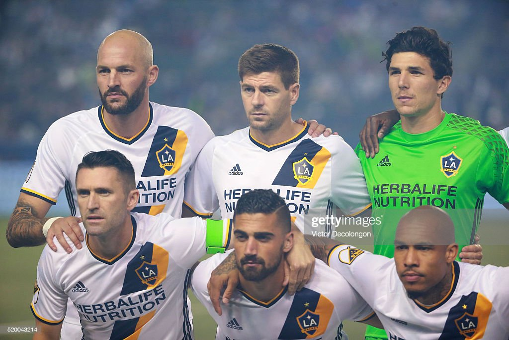 Jelle Van Damme #37, Steven Gerrard #8, goalkeeper Brian Rowe #12, Robbie Keane #7, Sebastian Lletget #17 and Nigel de Jong #34 of the Los Angeles Galaxy pose for a group photo with teammates prior to their MLS match against the San Jose Earthquakes at StubHub Center on March 19, 2016 in Carson, California. The Galaxy defeated the Earthquakes 3-1.