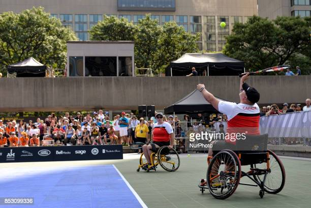 Jelle van der Steen and Ronald van Dort of the Netherlands compete in the Wheelchair Tennis prelims against Phil Badanai and Liz Steeves of Canada...