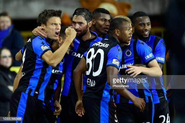 Jelle Vossen forward of Club Brugge celebrates scoring a penalty with teammates during the Jupiler Pro League match between Club Brugge and KSC...