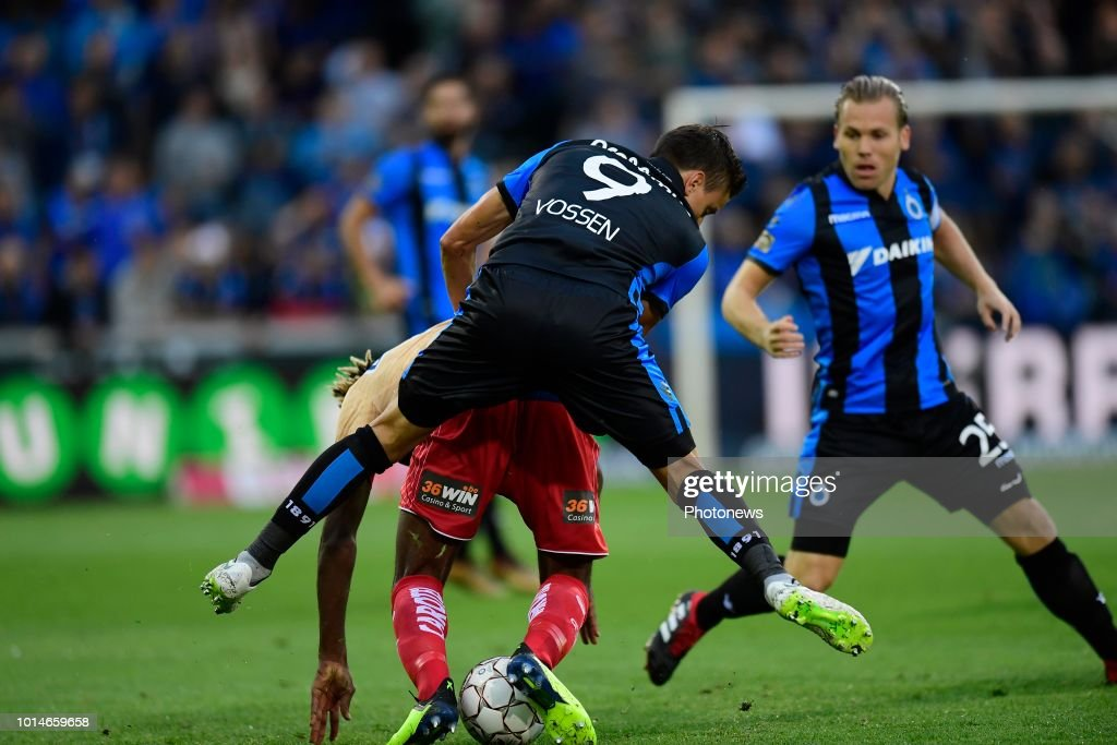 Jelle Vossen forward of Club Brugge jumps over Ilombe Mboyo forward of KV Kortrijk during the Jupiler Pro League match between Club Brugge and KV Kortrijk at the Jan Breydel stadium on August 10, 2018 in Brugge, Belgium,