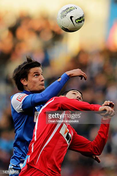 Jelle Vossen of Genk and Juan Alberto Andreu of Gent battle for the ball during the Jupiler League match between KRC Genk and KAA Gent at the Cristal...