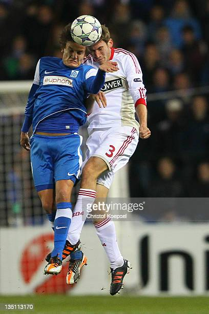Jelle Vossen of Genk and Stefan Reinartz of Leverkusen go up for a header during the UEFA Champions League group E match between KRC Genk and Bayer...