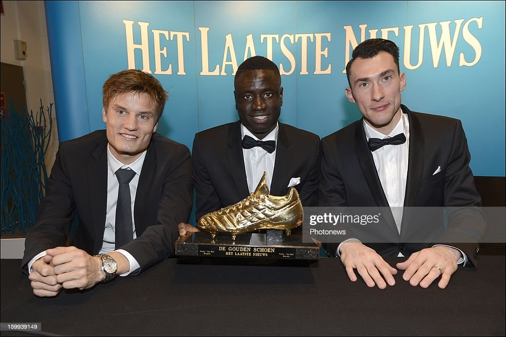 Jelle Vossen, Sivio Proto and Cheikhou Kouyate, who received the award for Dieumerci Mbokani attend a press conference during the 59th edition of the Golden Shoe Award ceremony at theVTM studios on Janaury 23, 2013 in Vilvoorde, Belgium. The Golden Shoe (Gouden Schoen/Soulier d'Or) was awarded for the best soccer player of the Belgian Jupiler Pro League during the year 2012.