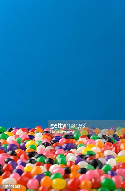 jelly beans against blue background, nice for easter - easter candy stock pictures, royalty-free photos & images