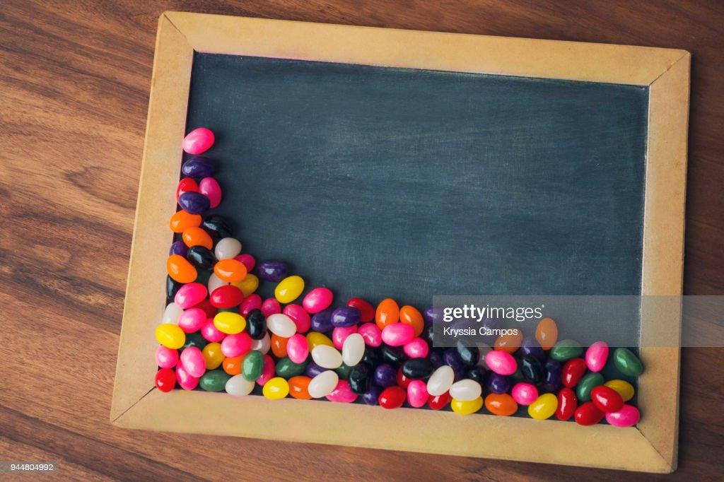 Jelly beans on a blackboard : Stock Photo