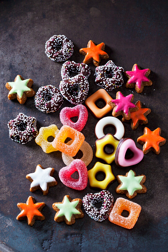 Jelly confectionery, coloured cinnamon stars and other Christmas cookies on dark ground - gettyimageskorea