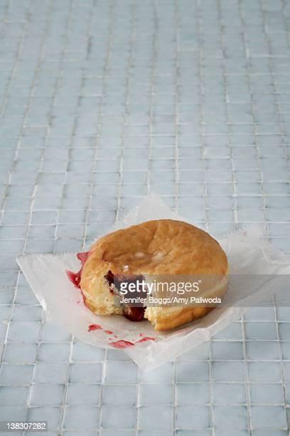 Jelly donut on bathroom floor