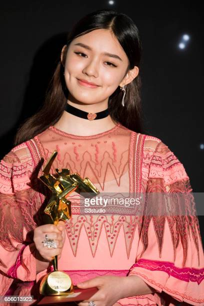 Jelly Lin, winner of the Rising Star of Asia for 'Mermaid', poses with the award during the 11th Asian Film Awards on March 21, 2017 at Hong Kong...