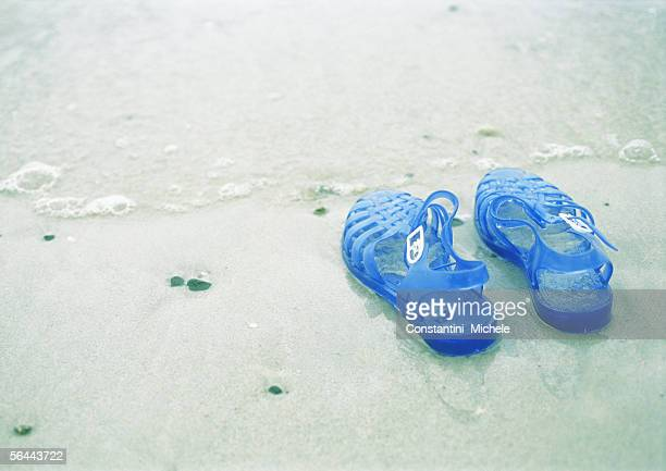 jelly shoes on beach - jelly shoe stock pictures, royalty-free photos & images