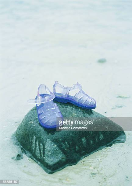 jelly shoes on rock - jelly shoe stock pictures, royalty-free photos & images