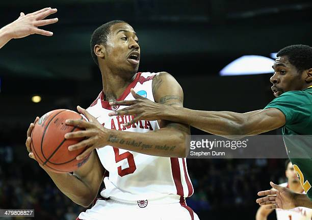 Je'lon Hornbeak of the Oklahoma Sooners keeps posession of the ball against the North Dakota State Bison during the second round of the 2014 NCAA...