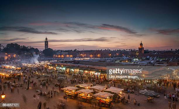 jemaa el-fnaa square illuminated at dusk, marrakesh, morocco - djemma el fna square stock photos and pictures