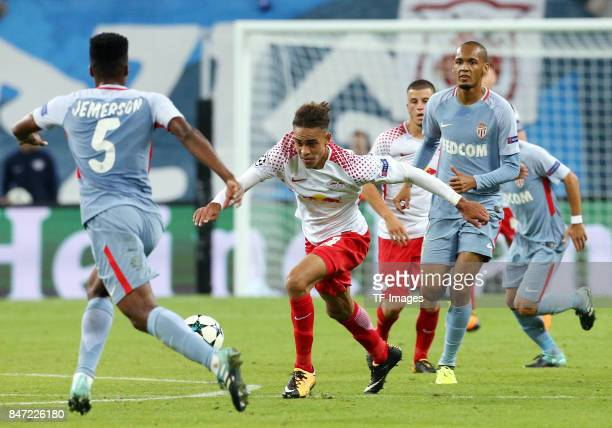 Jemerson of Monaco and Yussuf Poulsen of Leipzig and Fabinho of Monaco battle for the ball during the UEFA Champions League group G match between RB...