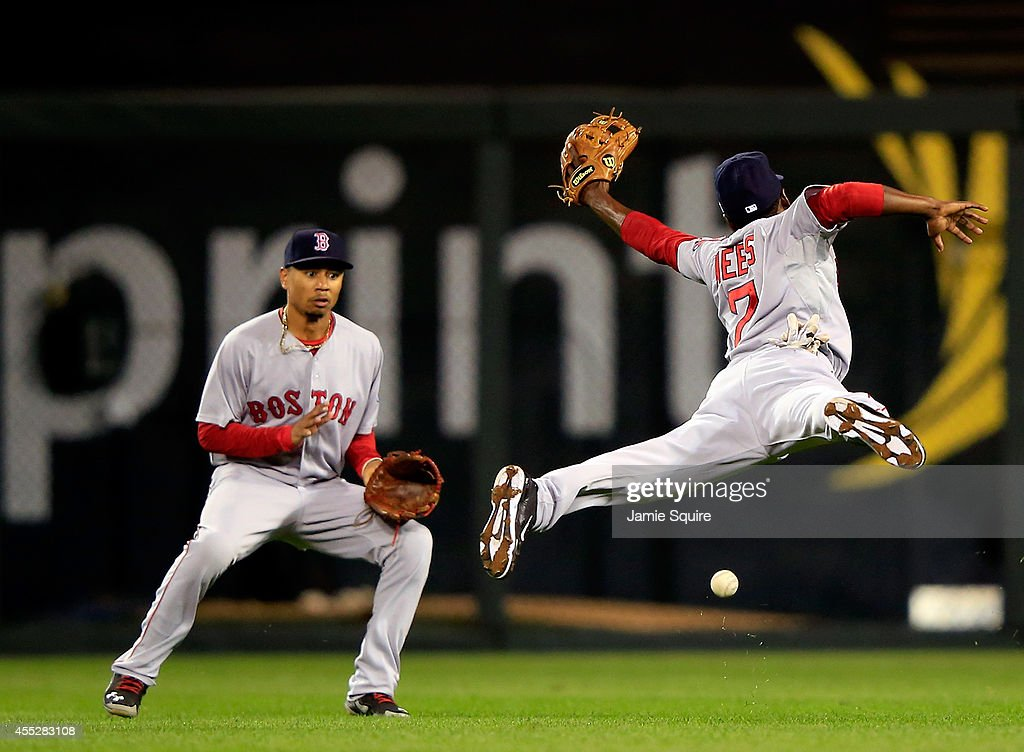 Boston red sox v kansas city royals jemile weeks 7 of the boston red sox leaps but misses a blooper hit by voltagebd Images
