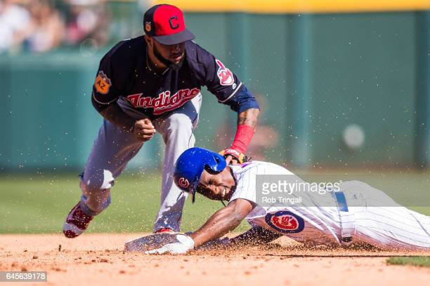 Jemile Weeks of the Chicago Cubs slides safely into second base before the tag by Ronny Rodriguez of the Cleveland Indians in the fourth inning...
