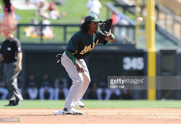 Jemile Weeks of the Oakland Athletics covers second base against the Colorado Rockies at Salt River Fields at Talking Stick on March 9 2012 in...