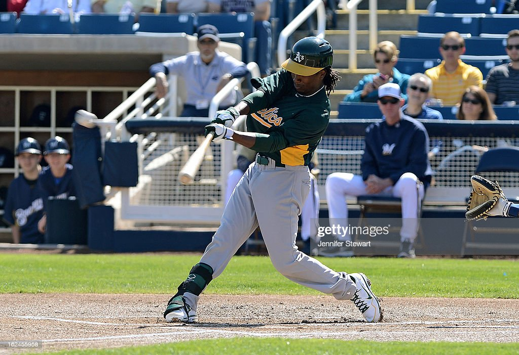Jemile Weeks #19 of the Oakland Athletics hits a double in the spring training game against the Milwaukee Brewers at Maryvale Baseball Park on February 23, 2013 in Phoenix, Arizona.