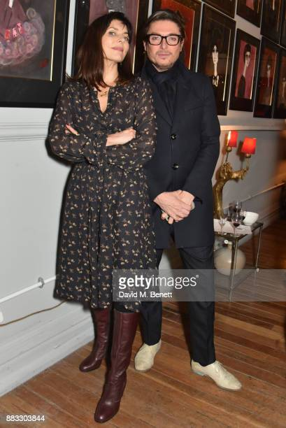 Jemima French and Darren Strowger attend a private view of artist Rebecca Leigh's exhibition hosted by Sadie Frost at Tann Rokka on November 30, 2017...