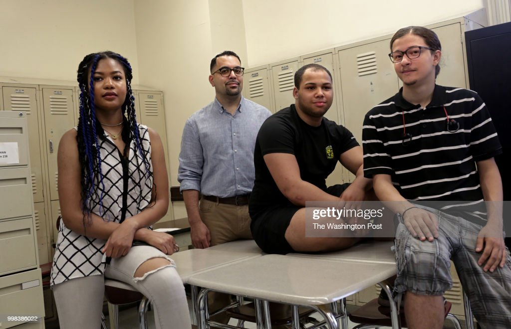 Jemima Joseph, 17 (left,) a high school graduate of the Morris Academy for Collaborative Studies, poses for a portrait alongside Daniel Polanco, 17 (second from right,) a junior, and Alexis Ortiz Estrella, 17 (right,) another graduate, in the Bronx, NY, on July 11, 2018. Carlos Acevedo, a senior English teacher and technology coordinator at the school, stands next to her