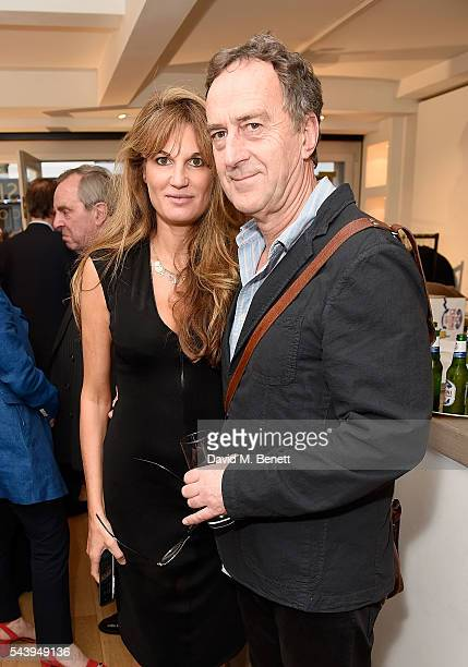 Jemima Khan and Angus Deayton attend the exhibition launch party of 'The Zero Hour Panoramas' by Jolyon Fenwick The exhibition consists of 14...