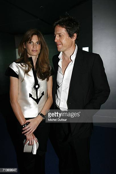 Jemima Khan and Hugh Grant attend a retrospective of the work of Cristobal Balenciaga at the Museum of Fashion and Textiles July 4 2006 in Paris...