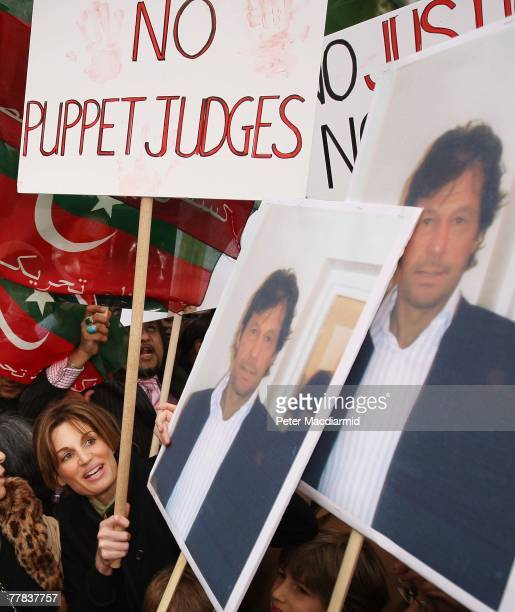 Jemima Khan looks up at placards of her former husband and Pakistani politician Imran Khan during a protest calling for democracy in Pakistan on...