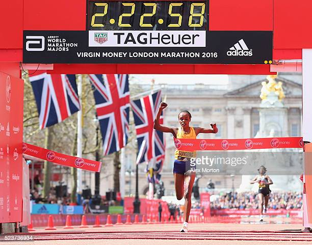 Jemima Sumgong of Kenya wins the Elite womens race during the Virgin Money Giving London Marathon at the finish on The Mall on April 24 2016 in...