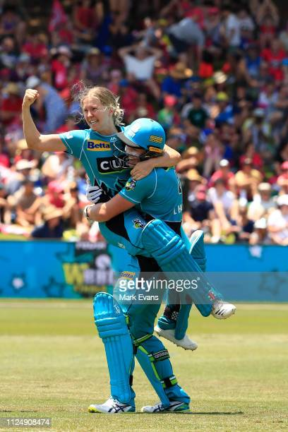 Jemma Barsby and Laura Harris of the Heat celebate their win during the Women's Big Bash League Final between the Sydney Sixers and the Brisbane Heat...