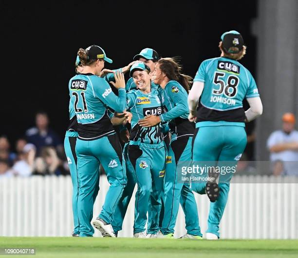Jemma Barsby of the Heat celebrates after taking the catch to dismiss the wicket of Bridget Patterson of the Strikers during the Womens Big Bash...