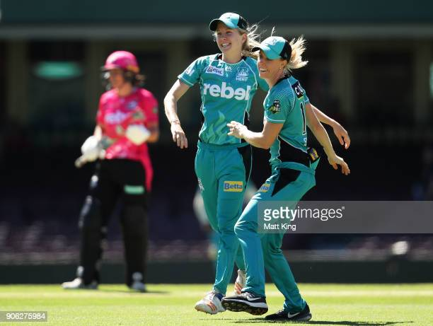 Jemma Barsby of the Heat celebrates with Kirby Short after taking the wicket of Alyssa Healy of the Sixers during the Women's Big Bash League match...