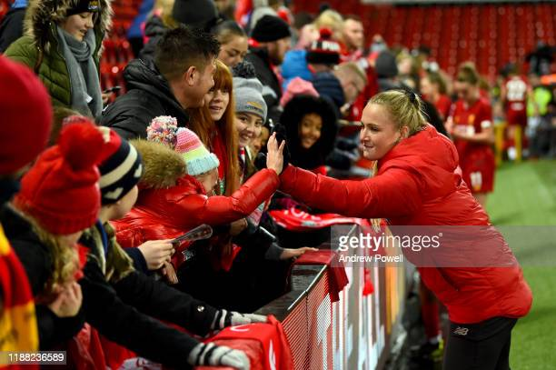 Jemma Purfield of Liverpool Women signing autographs at the end of the Barclays FA Women's Super League match between Liverpool and Everton at...