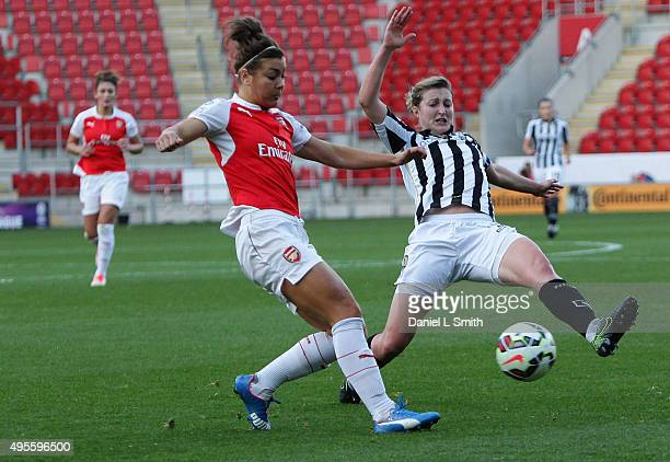 Jemma Rose of Arsenal Ladies FC is tackled by Ellen White of Notts Ladies County FC during the WSL Continental Cup Final between Arsenal Ladies FC...