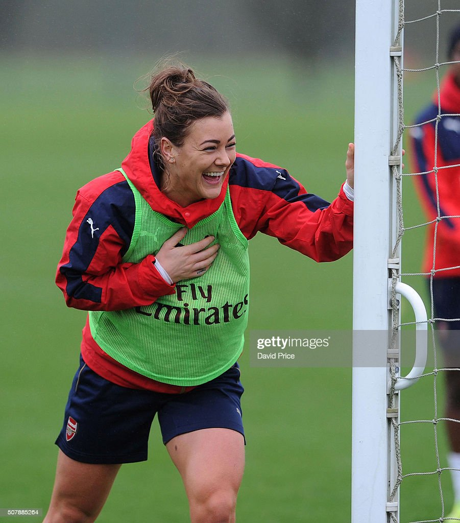 Jemma Rose of Arsenal Ladies laughs during the Arsenal Ladies training session at London Colney on January 29, 2016 in St Albans, England.