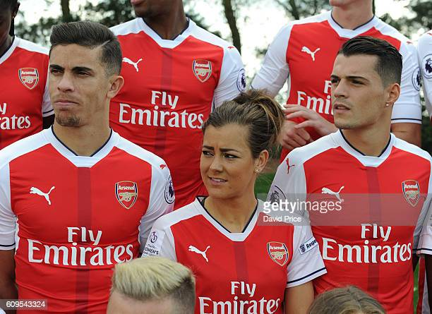 Jemma Rose of Arsenal Ladies with Gabriel and Granit Xhaka of Arsenal during the Arsenal Squad photos at London Colney on September 21 2016 in St...