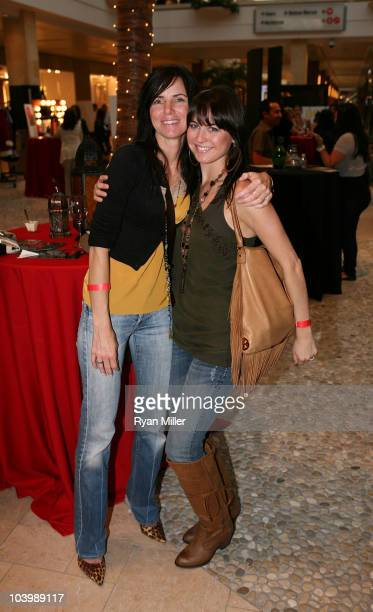 Jemma Wildermuth and Amber Thayer pose during Fashion's Night Out at the Westfield Topanga Mall on September 10 2010 in Culver City California