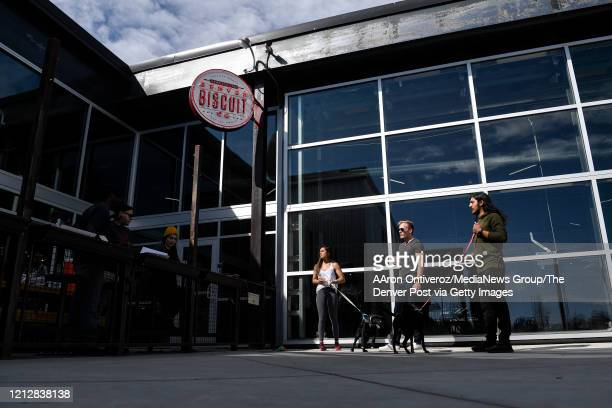 JEmployees of Denver Biscuit Company at Stanley Market Place await the arrival of customers for pickup orders on Monday March 16 2020 Mayor Michael B...