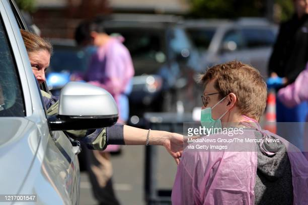 Jen Aronowitz of Los Altos talks to Stanford medical student Thomas Koehnkz as he takes her blood sample during a coronavirus antibody study at...