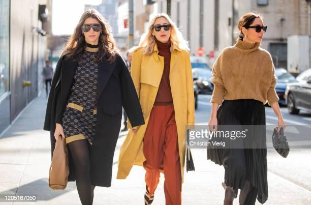 Jen Azoulay, Angela Fink wearing yellow coat, rust brown turtleneck, red pants and Geraldine Boublil is seen wearing brown turtleneck knit, black...
