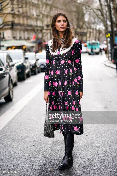 Jen Azoulay wears a black and pink floral print dress, a metallic silver bag, black leather boots, outside Paco Rabanne, during Paris Fashion Week -...
