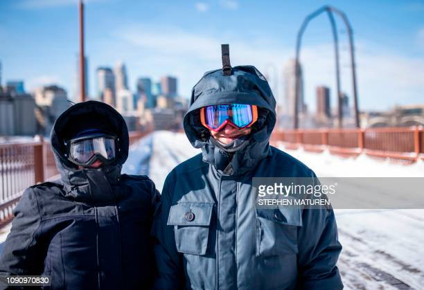 Jen Brackman and Aaron Brackman don large jackets and goggles while on a walk on the Stone Arch Bridge on January 29 2019 in Minneapolis Minnesota...